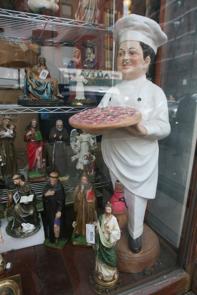 Pizza  Man and Religious Statues