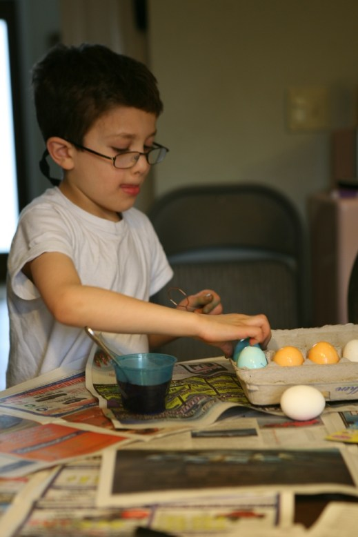 Michael dyes one of his eggs blue