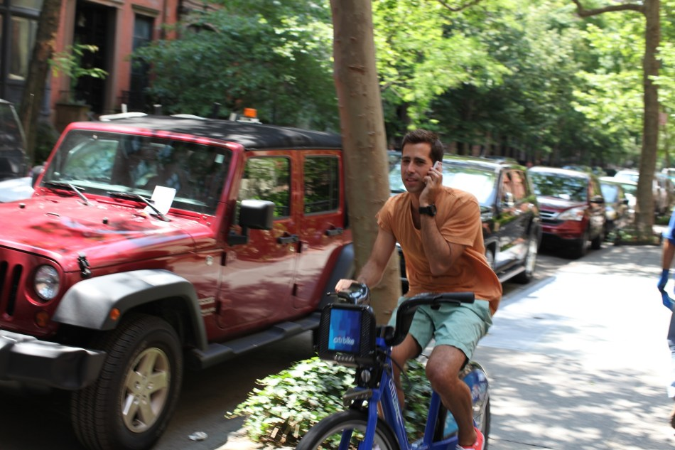 Man on cell phone on bike