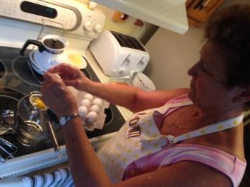 Aunt Linda cracks the eggs