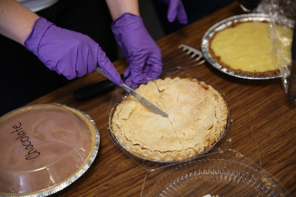cutting slices of pie