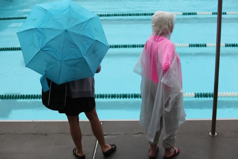 spectators in the rain