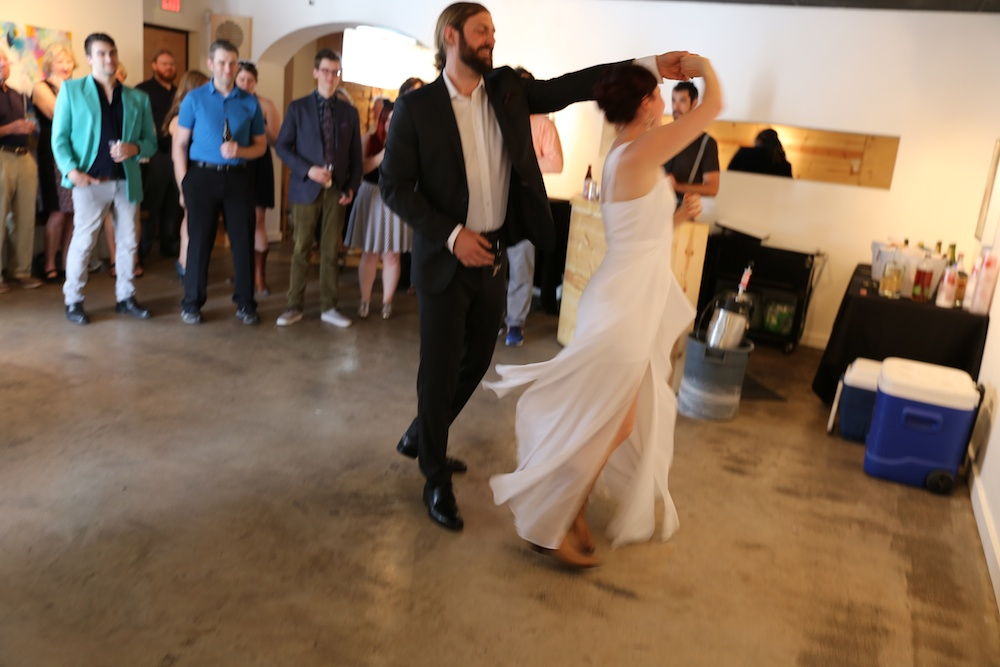 bride in boots dancing