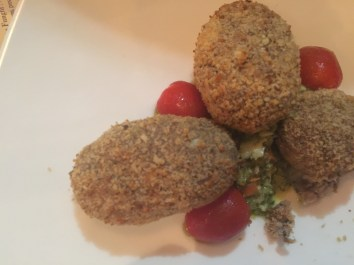 Polpete Toscane baked meatballs of beef and pork with a fresh herb green sauce
