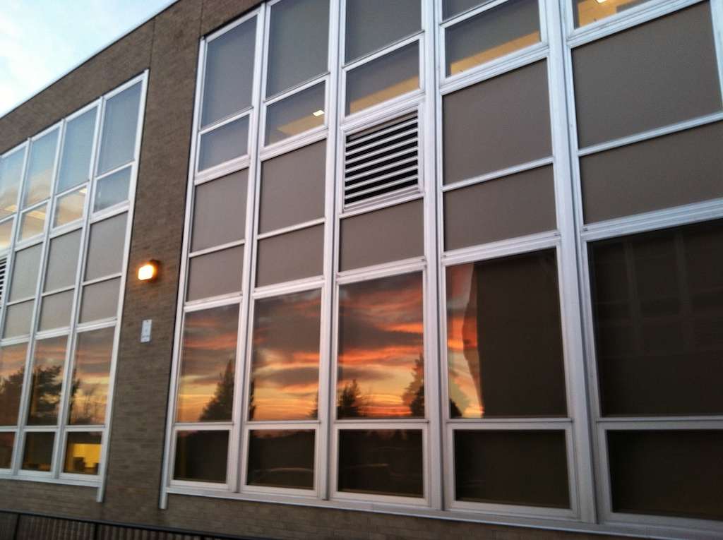 Sunset Reflected in School Windows