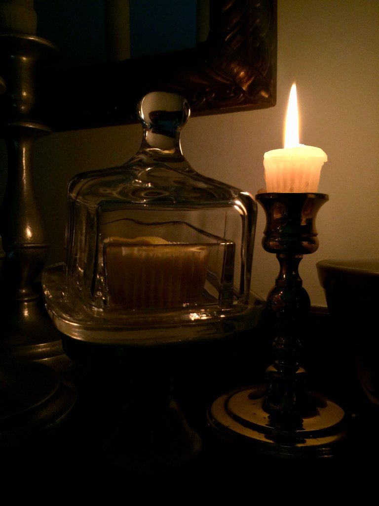 candle and cupcake under glass