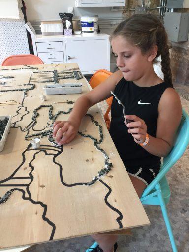 Maura works on a mosaic