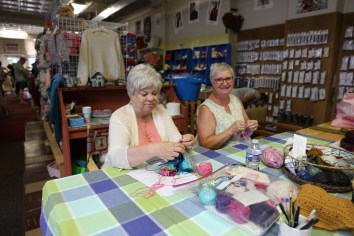 Every Friday morning as many as twenty knitters gather around this table to knit.
