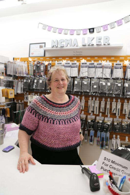 Amy McCall Owner of McWalker Yarns sporting her beautiful Soldotna Crop Sweater designed by Caitlin Hunter