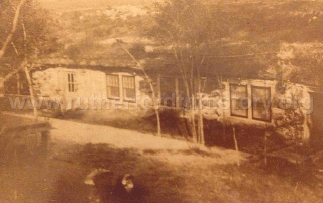 This snapshot, circa 1933, shows how the mouth of (Black Cat Cave (aka Rainbow Cave) was enclosed for the Black Cat Tavern. In the foreground is a 1928 Star automobile owned by Pauline Neely, the last tavern operator. The cave was on the J. T. Sullivan farm, now part of Murfreesboro Parks & Recreation.