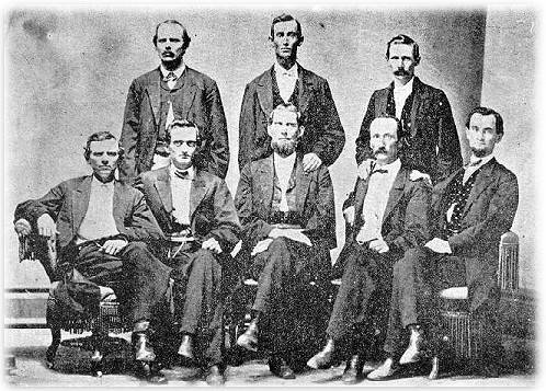 "Members of the legendary group of heroes known as ""Coleman's Scouts"", the eyes and ears of the Army of Tennessee, assemble secretly in Nashville in 1866 for their one and only reunion. Pictured above, seated from left to right, are W. M. Roberts, Sam Roberts, Capt. Henry B. Shaw (alias Coleman), J. M. Shute, and George D. Hughes. Standing, also from left to right, are W. H. Porch, John G. Davis, Robert F. Cotton. Present only in spirit were their many comrades who perished during the late war, including the martyred Sam Davis and Dewitt Smith Jobe.  Less than a year after this  photograph was taken both Henry B. Shaw and John G. Davis (Sam Davis' older half~brother) would also be gone, killed in the February, 1867 explosion of the steamer ""David White"" on the Mississippi River."