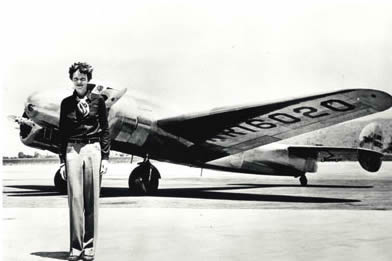 Amelia Earhart and her plane (photo from Special Books)