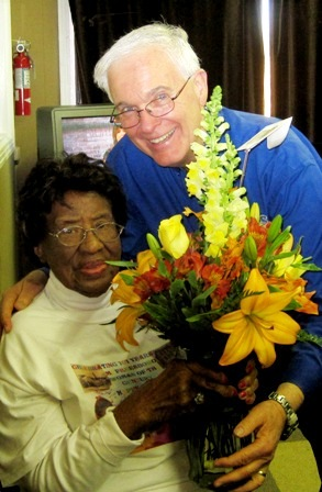 WGNS Radio's Bart Walker presents Miss Dora a bouquet of flowers when she was a guest on the WGNS' Action Line 11/11/2011.