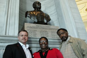 State Reps. Mike Sparks (R-Smyrna), Karen Camper (D-Shelby County) and John DeBerry (D-Memphis) stand by a bust of Sampson Keeble, Tennessee's first black legislator, which graces the entrance to the Tennessee House Chambers.