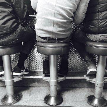 Threee butts on stools
