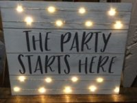 Wedding signage with twinkle lights. The Party Starts Here