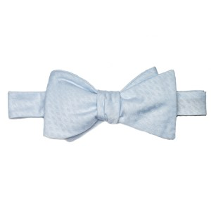tied light blue bow tie with textured pattern