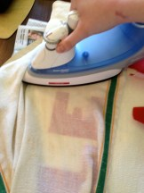 "Ironing on the ""Wonder Under"" backed letters to the pillow case."