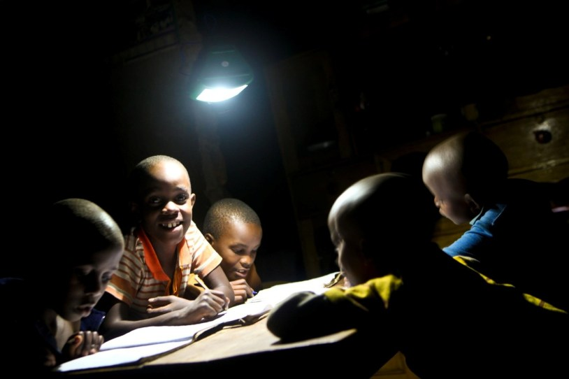 CHILDREN USING SOLAR LAMP