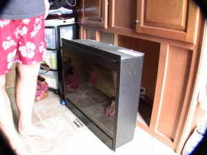 RV fireplace showing unit removed from mounting location