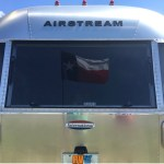 Texas Freedom in the Back Window of an Airstream