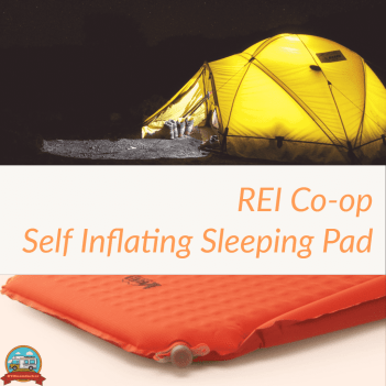 REI Co-op brand sleeping pad for camping pictured with a tent