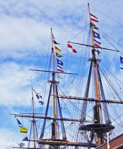 """Naval signal flags have long been used to """"stand for"""" words or phrases useful in coordinating naval maneuvers. Here the museum ship HMS Victory spells out the message, """"England expects that every man will do his duty"""" made famous during the battle of Trafalgar"""