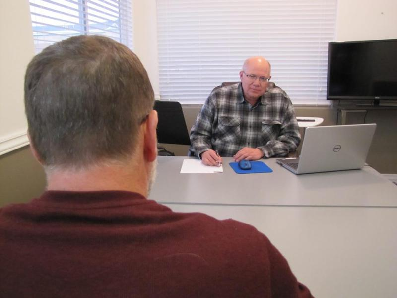 Instructor Paul H. Smith, PhD monitoring student Russell Pickering working on a controlled remote viewing session