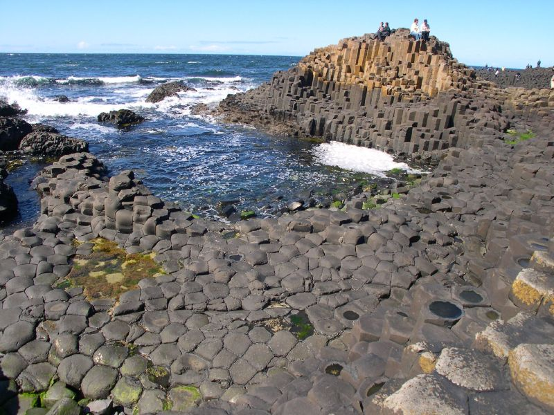Another image of remote viewing target 210120418 with people to show the scale of the Giant's Causeway