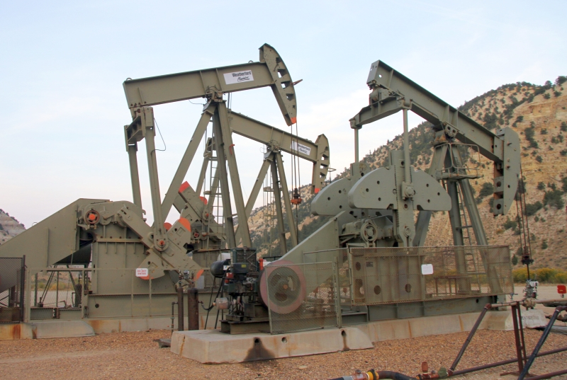 Another view of remote viewing Target 210303573, a set of oil field pump jacks next to UT Hwy 191