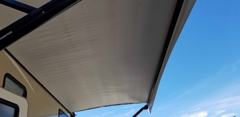 RV awning fully extended and clean.