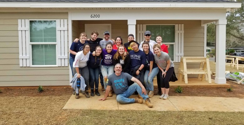 Massachusetts College of Pharmacy and Health Sciences volunteering with Habitat for Humanity.
