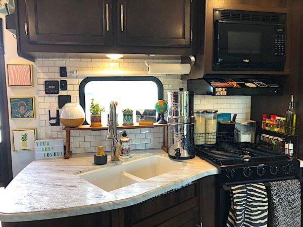 Peel-and-stick subway tile backsplash in an RV kitchen