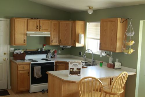 Oak cabinets with green walls