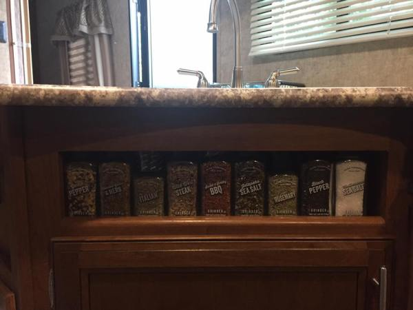 spices in under cabinet hole
