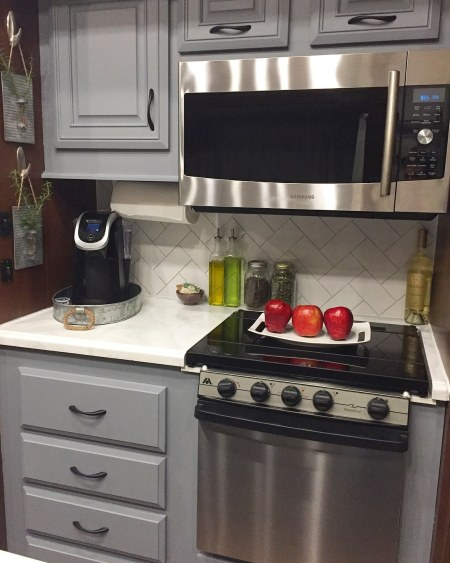 #RV #kitchen #makeover with painted cabinets, painted countertops, and new backsplash