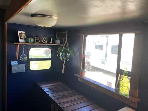 Travel trailer RV with wood framed windows