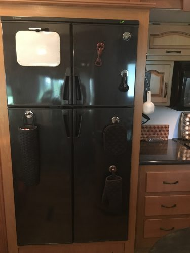 Items hung on refrigerator with magnetic hooks | RVinspiration.com | Storage and organization ideas for campers, RVs, motorhomes, and travel trailers