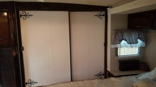Bead board wallpaper and decal hinges on mirror closet sliding door in RV, camper, motorhome, or travel trailer