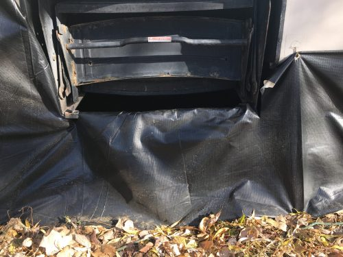 Homemade DIY RV trailer skirting from billboard tarp vinyl for around $200 to get ready for cold weather winter camping