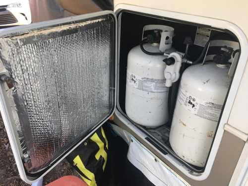 Reflectix Insulation taped inside door of propane tank area