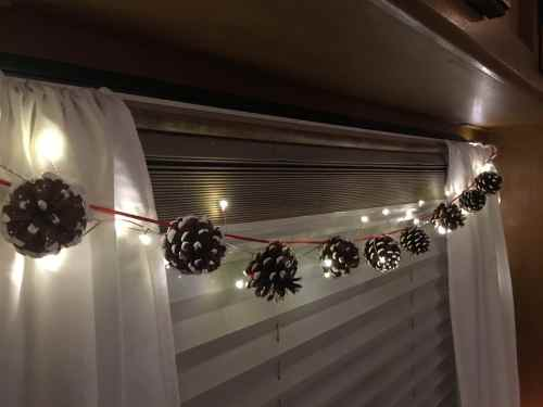 White tipped pine cone garland with LED fairy lights winter RV decor perfect for Christmas