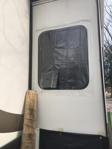 Clear vinyl used to cover an RV window to add extra insulation from cold weather during winter