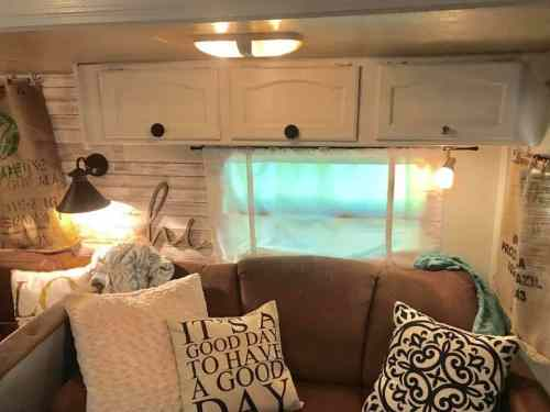 Travel trailer living room with Farmhouse style decor by Brooke Seaman