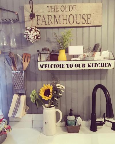 Farmhouse decor in toy hauler RV converted to tiny home by Robyn Crowhurst