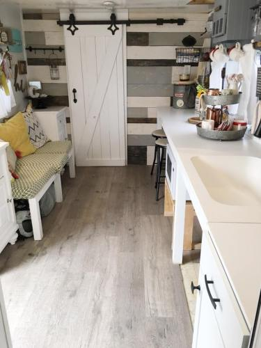 Toy hauler RV converted to Farmhouse style tiny home by Robyn Crowhurst