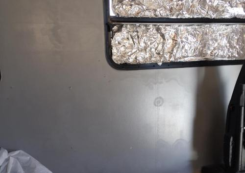 Newly painted walls in this camper developed a mysterious splotchy residue after a space heater was aimed at it.
