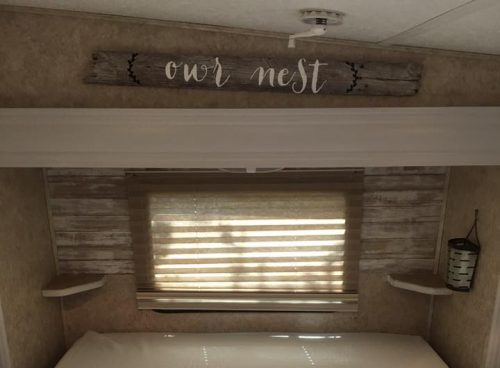 White painted trim and faux plank wall in fifth wheel RV by Kimberlyn McFadden
