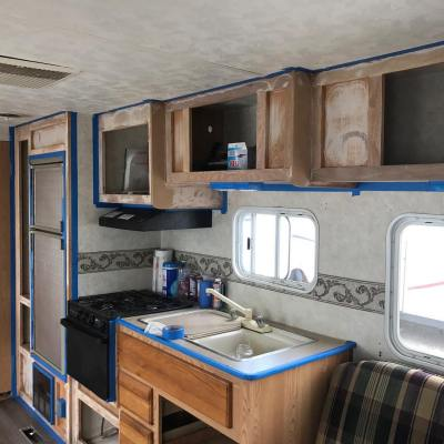 Travel trailer cabinets sanded, taped, and ready for painting