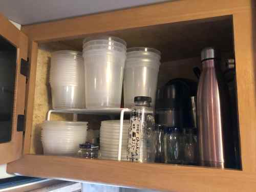 Using plastic deli containers for leftover food storage can help save space in an #RV #kitchen cabinet.